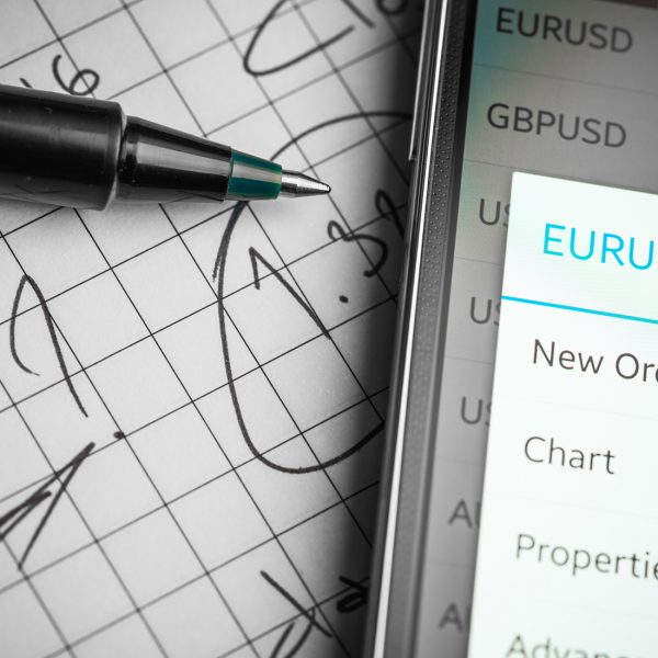 "Data analyzing in forex market: the charts and quotes on smartphone display. Analytics  pair U.S. dollar """" Euro."